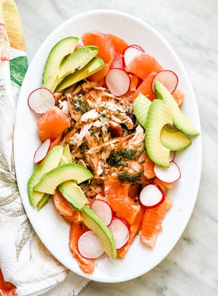 A colorful healthy main dish featuring salmon with dill