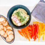 edamame hummus with tai color pepper and crackers in dish