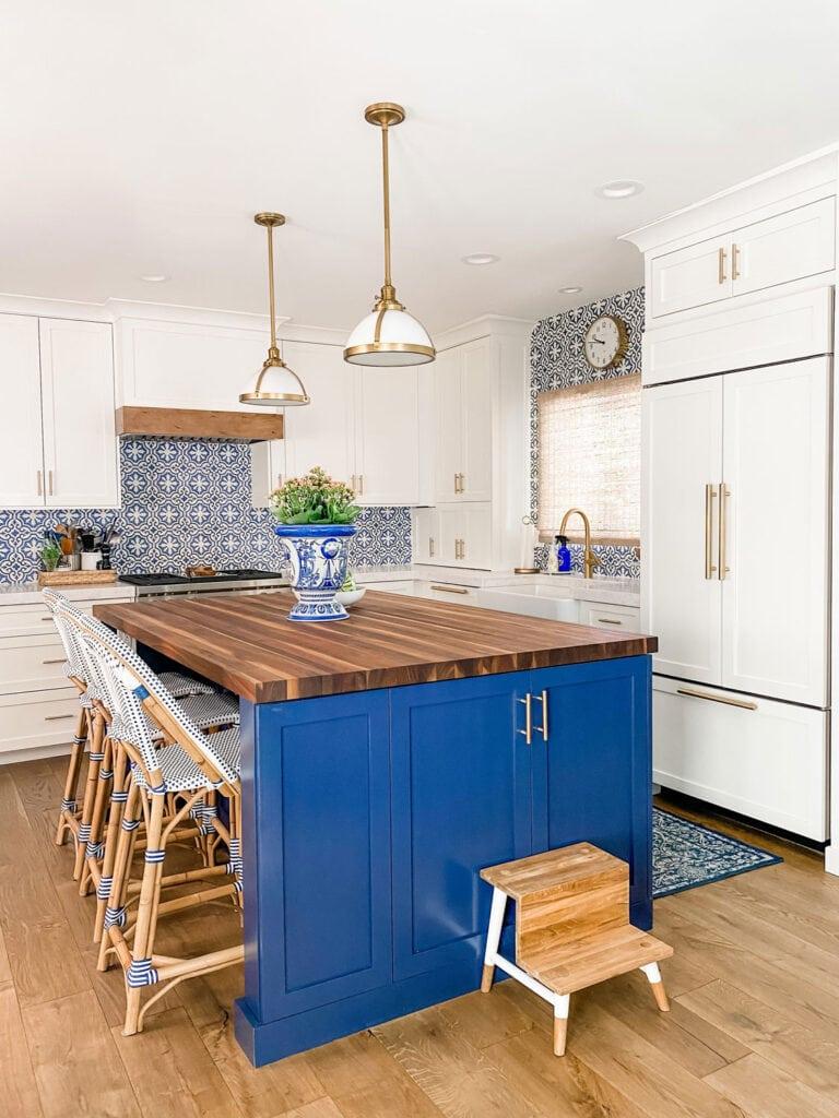 kitchen island with stills, step stool, butcher block top
