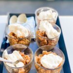 coffee granita in clear glass cups on a tray with whipped cream