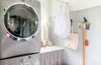 stackable washer and dryer, small folding area with bar above for hangers