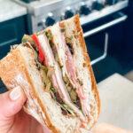 layered sandwich wedge in hand