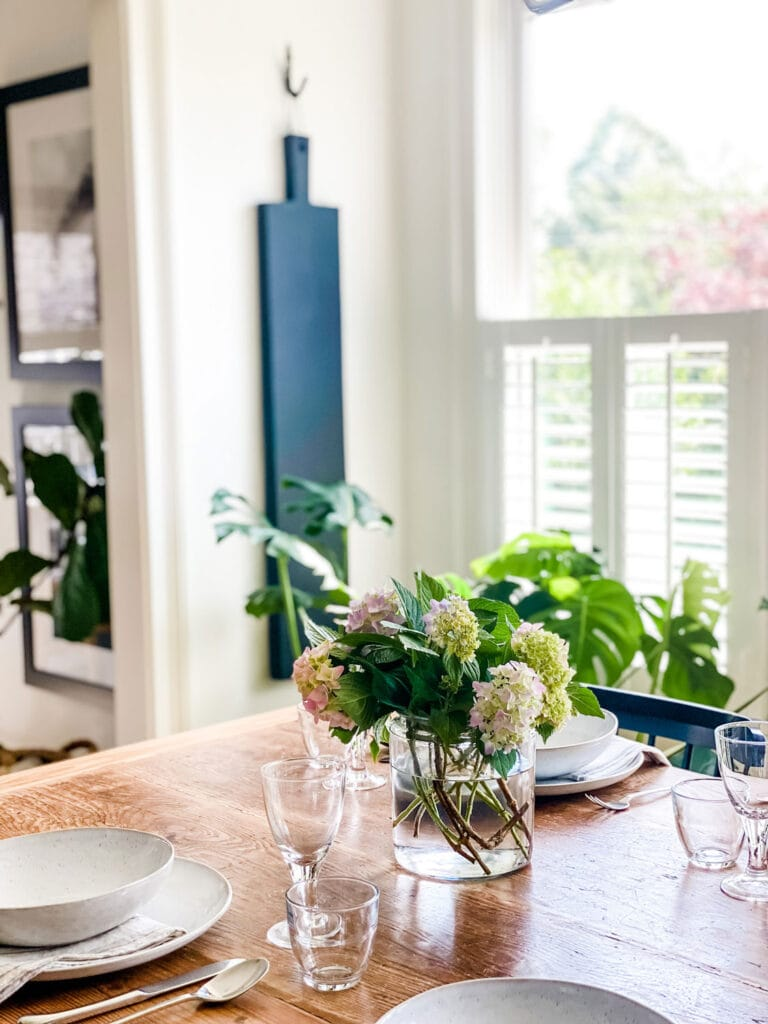 black farm plank on wall in dining room with shutters