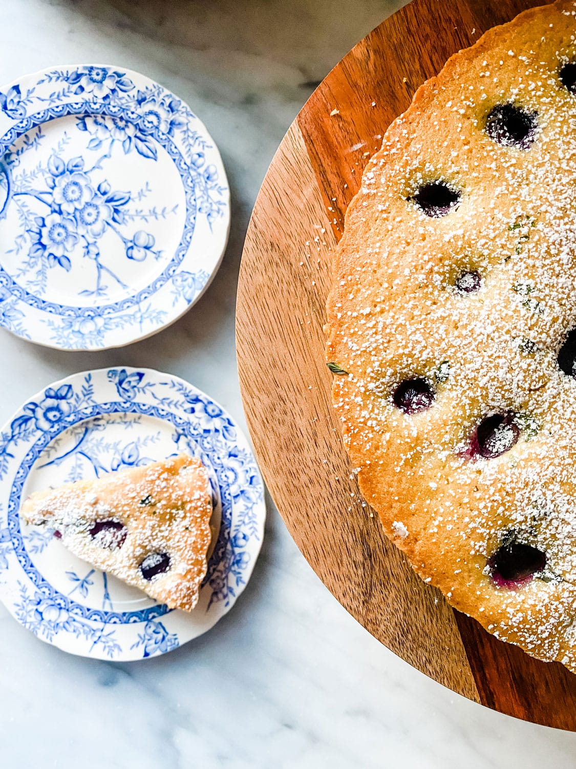 This Thomcord Grape Harvest Cake is slightly sweet, but earthy from the olive oil and fresh thyme too! Perfect for after dinner, lunch or serve for breakfast. It can be made ahead!