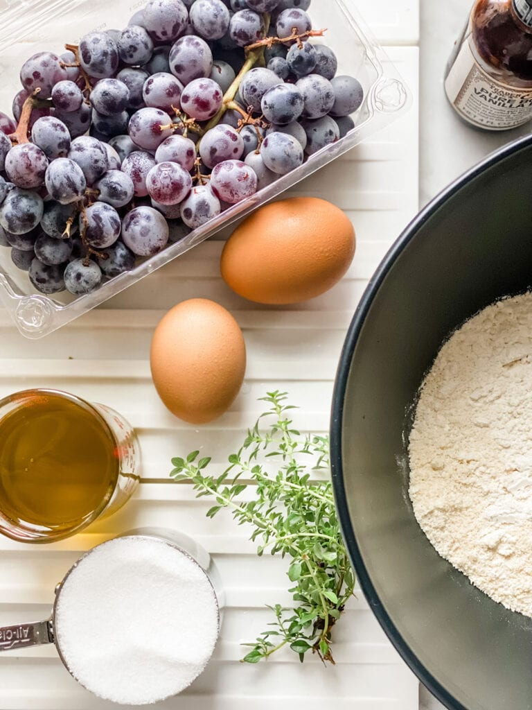 This Thomcord Grape Harvest Cake is slightly sweet, but earthy from the olive oil and fresh thyme too! Perfect for after dinner, lunch or serve for breakfast.