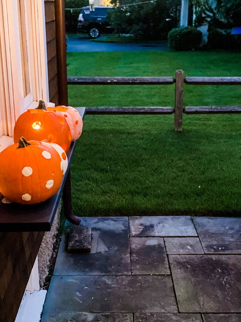 We recently hung this shelf over using a window box and turns out it's perfect for our pumpkin display.