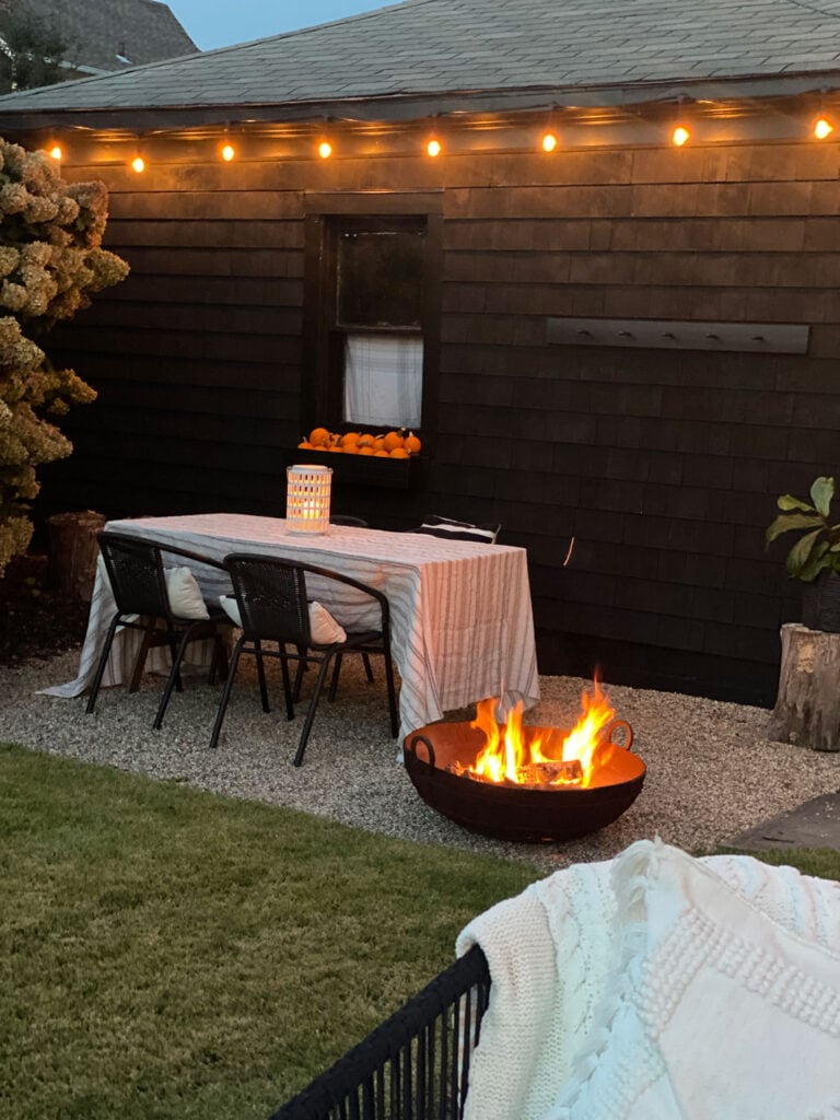 A fire-pit and string lights (incandescent of course) make the patio so cozy!
